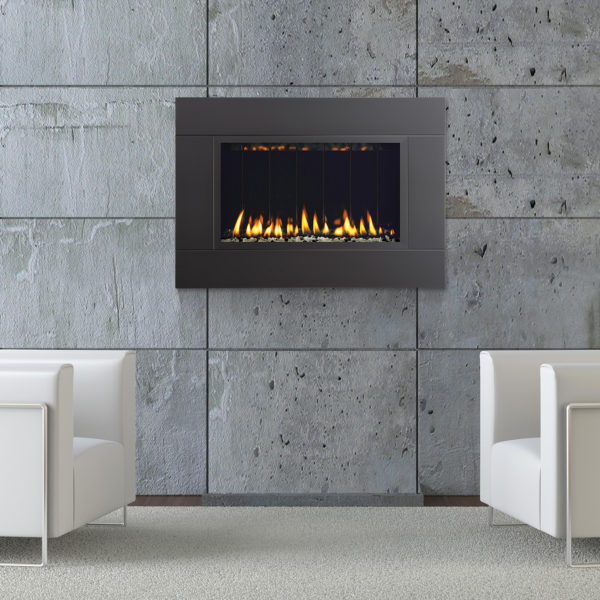 interior design of modern armchairs on front of a concrete fireplace